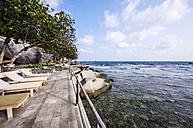 Indonesia, Riau Islands, Bintan, Nikoi Island, Sun loungers by the sea - THA000376
