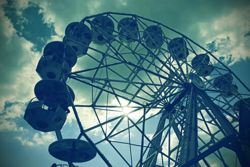 Germany, big wheel in front of cloudy sky, partial view from below - HOH000804