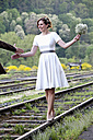 Bride balancing on rail - ND000455