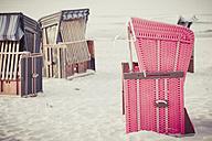 Germany, Mecklenburg-Western Pomerania, Ruegen, Closed beach chairs on beach - MJF001184