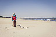 Germany, Mecklenburg-Western Pomerania, Ruegen, Schaabe, Boy on sandy beach - MJF001215