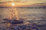 Germany, Mecklenburg-Western Pomerania, Ruegen, Dranske, Baltic Sea at sunset - MJF001237