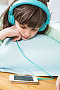Portrait of little girl with headphones and smartphone - LVF001305