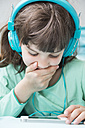 Portrait of little girl with headphones using smartphone - LVF001308