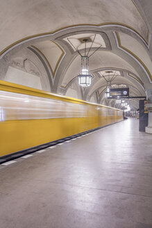 Germany, Berlin, historic subway station Heidelberger Platz with moving underground train - NKF000134