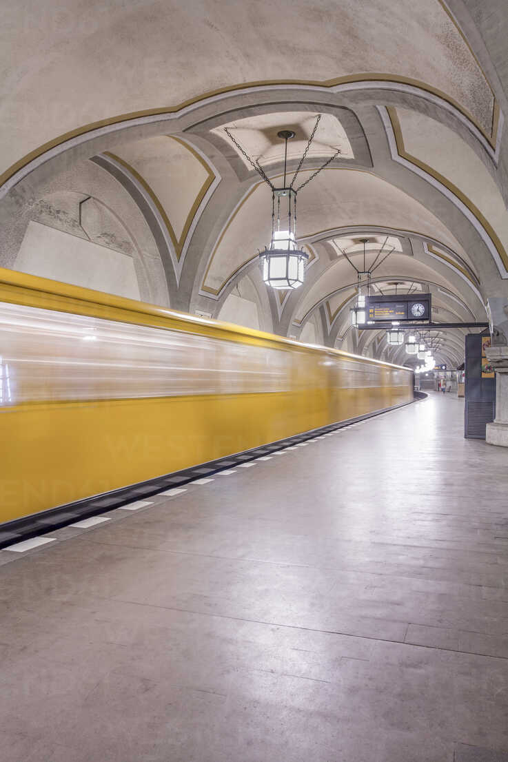 Germany, Berlin, historic subway station Heidelberger Platz with moving underground train - NKF000134 - Stefan Kunert/Westend61