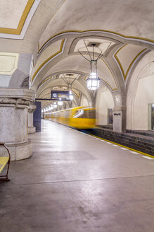 Germany, Berlin, historic subway station Heidelberger Platz with moving underground train - NKF000135