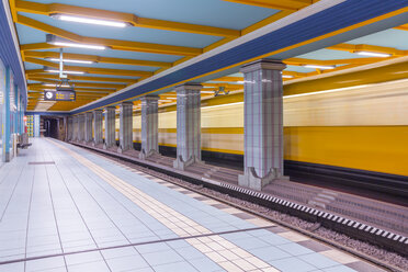 Germany, Berlin, subway station Lindauer Allee with moving underground train - NKF000140