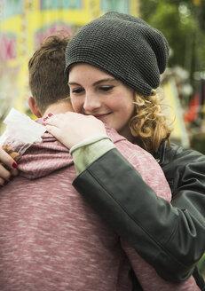 Teenage girl embracing her boyfriend - UUF000653