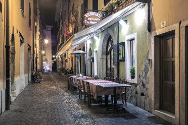 Italy, Trentino-Alto Adige, Riva del Garda, Restaurant by night - VT000233