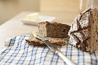 Buttering slice of wholemeal bread - SABF000006