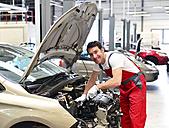 Car mechanic in a workshop working at car - LYF000013