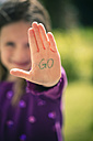 Little girl showing palm with the word GO on it - SARF000643