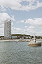 Germany, Schleswig-Holstein, Travemuende, Trave estuary, Lighthouse, Maritim Hotel at beach - MEMF000101