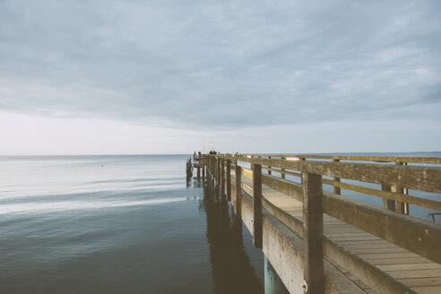Germany, Mecklenburg-Western Pomerania, Boltenhagen, Baltic Sea, Landing stage in the evening - MEMF000113