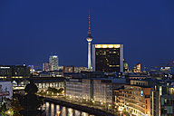 Germany, Berlin, Friedrichstrasse and TV tower at night - HHEF000097