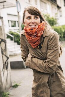 Portrait of freezing woman wearing orange scarf - MFF001106