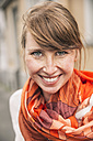 Portrait of smiling woman wearing orange scarf - MFF001104