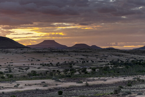 Africa, Namibia, Damaraland, view to grassland and volcanos by sunset - HLF000604