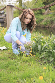 Young woman working in the garden - VTF000260