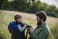 Germany, Rhineland-Palatinate, Moselsteig, father and his little son having a break from hiking - PA000698