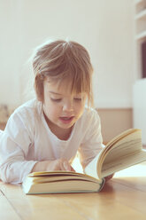Portrait of little girl with book - LVF001344