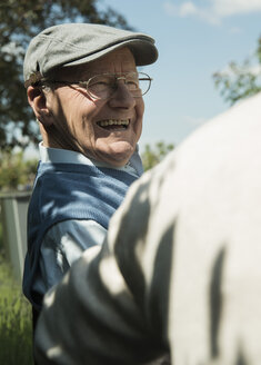 Portrait of happy old man wearing cap - UUF000676