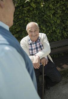 Portrait of happy old man witk walking stick - UUF000688