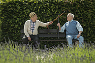 Germany, Worms, Two old friends sitting on bench in park - UUF000696