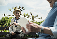 Germany, Worms, Two old men using tablet computers in the park - UUF000700