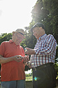 Two old friends with boule balls in the park - UUF000719