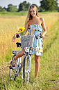 Young woman on bicycle tour in summer - GO000002