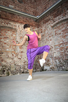Woman wearing sport dress dancing zumba or aerobics in gym - VTF000264