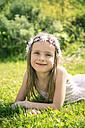 Smiling girl lying on meadow - SARF000681