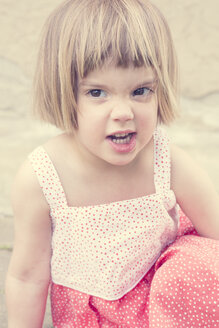 Portrait of little girl making a face - LVF001371