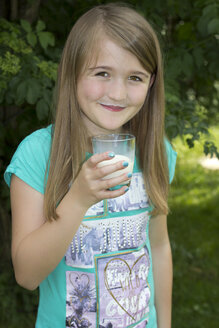 Portrait of smiling girl with milk moustache - YFF000158