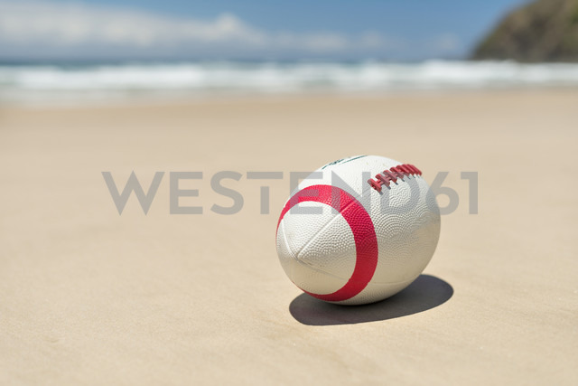 Australia, New South Wales, Byron Bay, Broken Head nature reserve, football in sand on beach - SHF001399