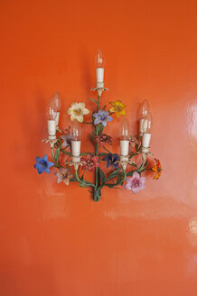 Old wall lamps hanging at glossy red wall - TK000351