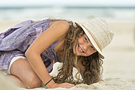 Australia, New South Wales, Pottsville, girl playing in sand on beach - SHF001361