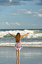 Australia, New South Wales, Pottsville, girl with long hair at the ocean with arms outstretched - SHF001396