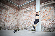 Young woman doing workouts in a gym - VTF000274