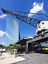 Germany, Hesse, Frankfurt, new building of European Central Bank with old harbour crane in the foreground - AMF002302
