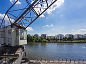 Germany, Hesse, Frankfurt, view over Main river to Sachsenhausen with old harbour crane in the foreground - AMF002304