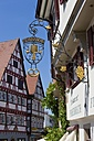 Germany, Baden-Wuerttemberg, Bad Wimpfen, view to historic half-timbered houses and golden inn sign - AM002334