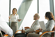 Group of businesspeople attending a seminar - WESTF019338
