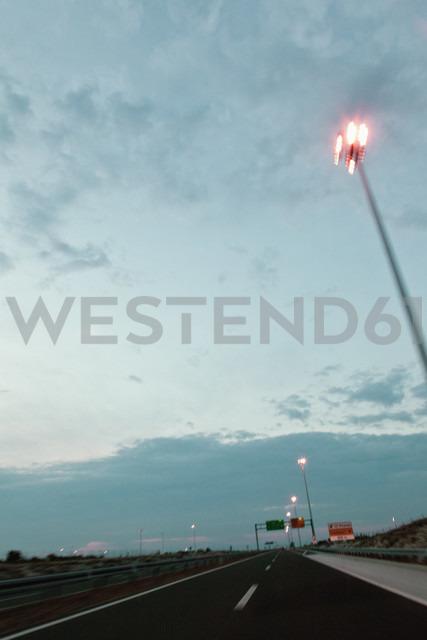 Germany,Bavaria, Fuessen, road in the evening with street lanterns - MEM000184