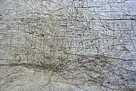 Withered and scratched wooden table, partial view - AXF000688