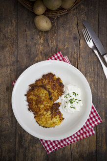 Potato fritters with quark and chives on plate - LVF001399