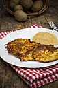 Potato fritters with apple sauce on plate - LVF001402