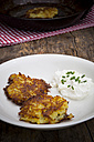 Potato fritters with quark and chives on plate - LVF001404